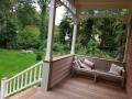 Amerikaanse veranda met trap en houten terras