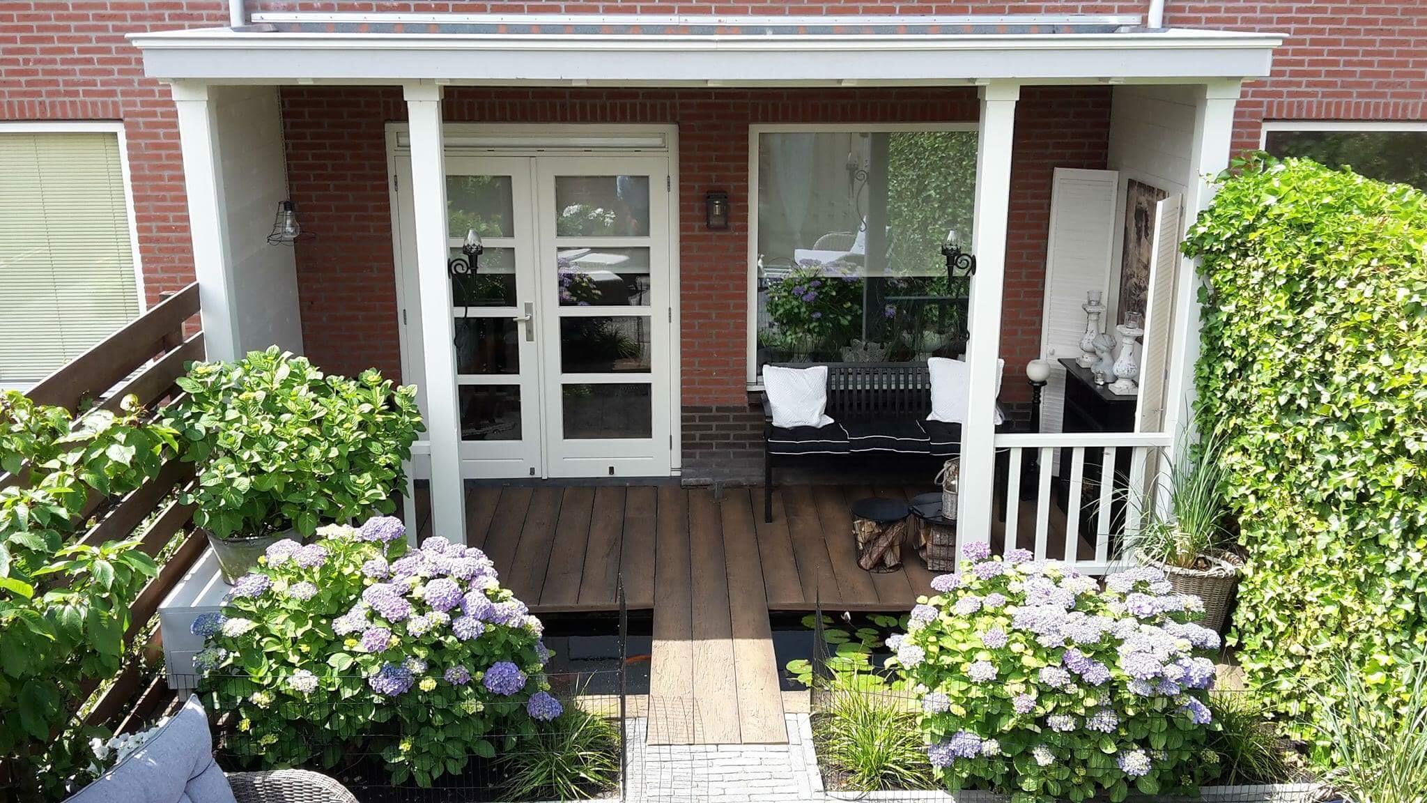 Sfeervolle veranda mer vijver