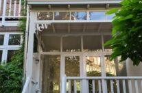 Veranda vakman bouwt aan herenhuis
