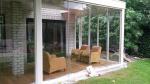 Veranda met glazen schuifwand